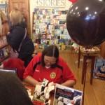 While I sign books...