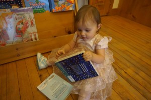 """People browse for other books. """"This one looks good."""""""